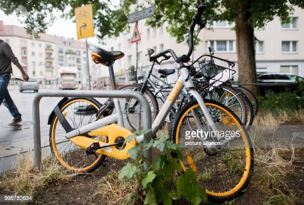 July 2018, Germany, Hanover: A bike by the rental bike provider OBike standing at the Goetheplatz. Photo: Julian Stratenschulte/dpa