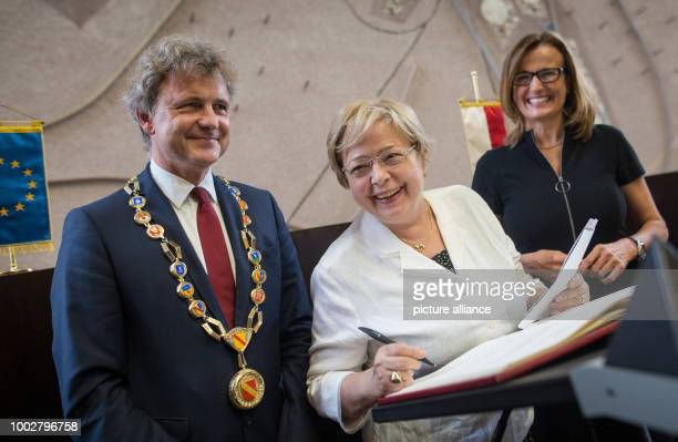 Malgorzata Gersdorf forced retired presiding judge from Warsaw vitis the German 'Capital of Law' and signs her name in the Golden Book at the Federal...