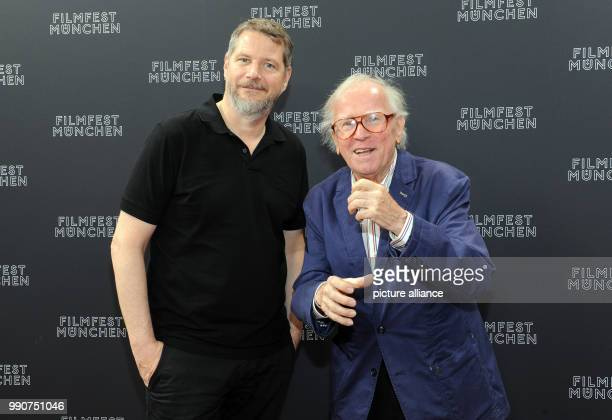 Director Andreas Prochaska and musician Klaus Doldinger arriving to a photo shoot for the series 'Das Boot' during the Munich International Film...