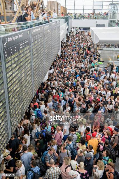Hundreds of passengers wait for their flights at Munich Airport's Terminal 2 The security zone in Terminal 2 at Munich Airport has been temporarily...