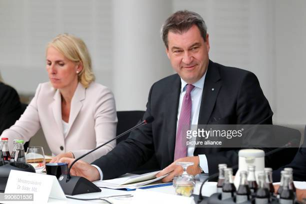 Premier of Bavaria from the Christian Social Union Markus Soeder opening the cabinet meeting next to State Counsellor Karolina Gernbauer The main...