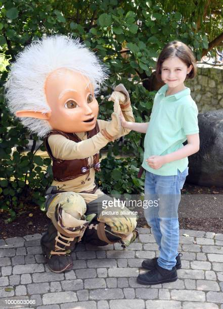 The 8 year old 'turbo pupil' Laurent Simons fromAmsterdam standing in the Europa park next to a figure of Arthur Laurent passed his alevels at 8...