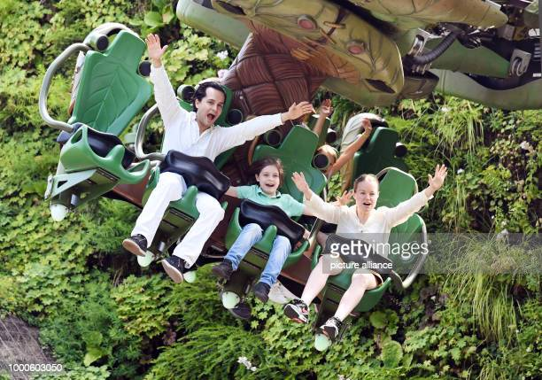 The 8 year old 'turbo pupil' Laurent Simons fromAmsterdam riding the Arthur ride with his parents Alexander and Lydia Simons at the Europa park...