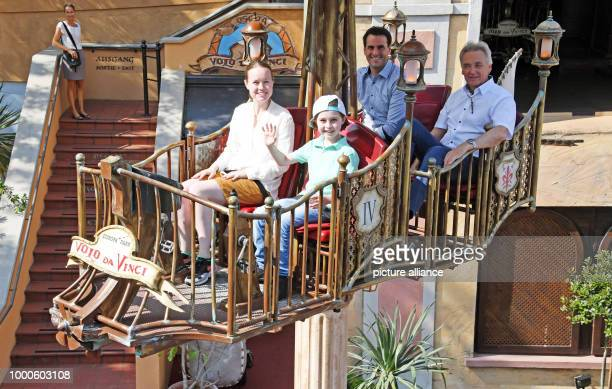 The 8 year old 'turbo pupil' Laurent Simons fromAmsterdam riding the Volo da Vinci ride with his mum Lydia at the Europa park Sat behind them are...
