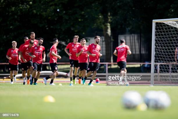 Soccer Bundesliga Fortuna Duesseldorf start of training Fortuna players among them newcomers Kenan Karaman and Marvin Ducksch during a running...