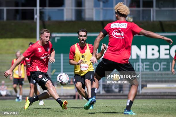 Soccer Bundesliga Fortuna Duesseldorf start of training Fortuna newcomer Kenan Karaman and Robin Bormuth vying for the ball during a training match...