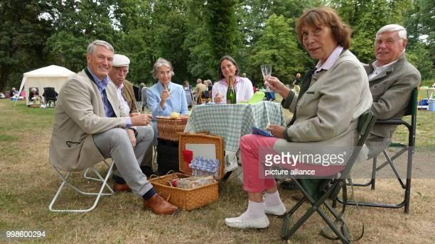 July 2018, Germany, Stocksee: Tim Scherer , Dietrich von Hirschheydt, Inge Scherer, Astrid Scherer, Peter Scherer and Monika von Hirschheydt sitting...