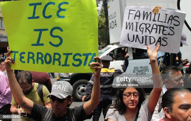 Migrant families belong together and ICE is terrorist can be read on signs of demonstrators during a protest in front of the meeting place of the...
