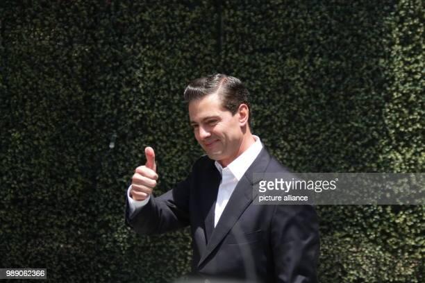 Enrique Pena Nieto president of Mexico gives a thumbs up after voting Photo Gerardo Vieyra/dpa