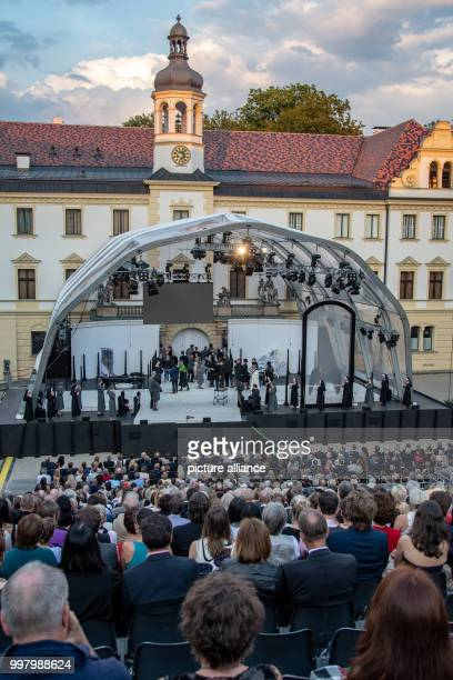 Visitors at the opening of the ThurnundTaxis Palace Festival with the opera piece Tosca in the inner courtyard of the count's palace St Emmeram Some...