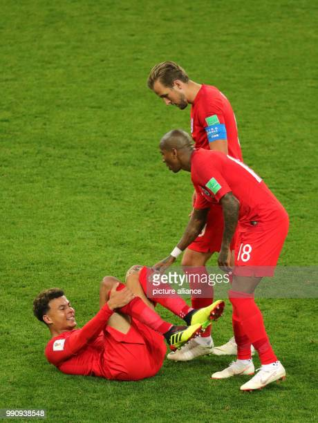 Soccer World Cup Eighth finals Colombia vs England in the Spartak Stadium England's Harry Kane and Ashley Young bending over for Dele Alli who is...