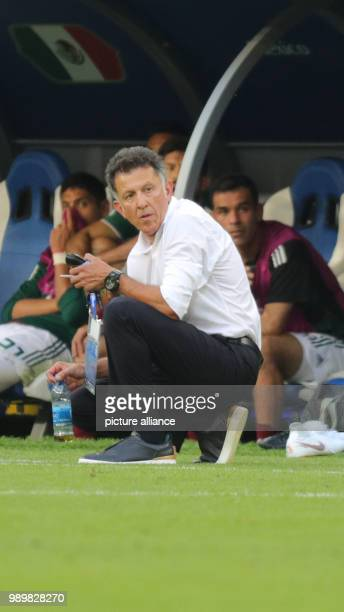 Soccer World Cup 2018 Final round round of 16 Mexico vs Brazil at the Samara stadium Mexico head coach Juan Carlos Osorio kneeling before the bench...