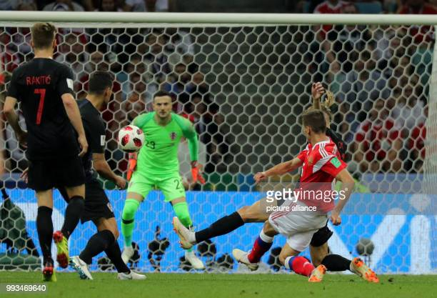 FIFA World Cup quarter final between Russia and Croatia at the Fisht Stadium Russia's Denis Cheryshev scores the 10 against Croatia's keeper Danijel...