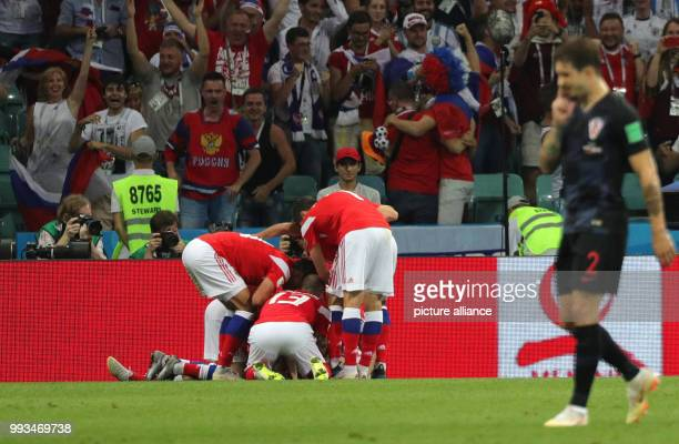 FIFA World Cup quarter final between Russia and Croatia at the Fisht Stadium Russia's Denis Cheryshev celebrates scoring the 10 with his teammates...