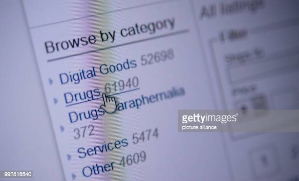A cursor is placed upon the button reading drugs on a darknet webpage Photo Sebastian Gollnow/dpa