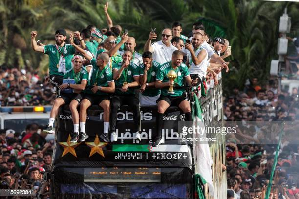 Algerian national soccer team players celebrate with thousands of supporters after having clinched the 2019 Africa Cup of Nations soccer trophy...