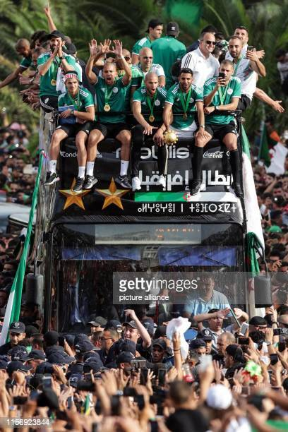 July 2019, Algeria, Algiers: Algerian national soccer team players celebrate with thousands of supporters after having clinched the 2019 Africa Cup...