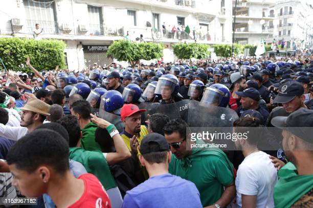 July 2019, Algeria, Algiers: Algerians scuffle with security forces during a march calling for the departure of the Algerian regime coinciding with...
