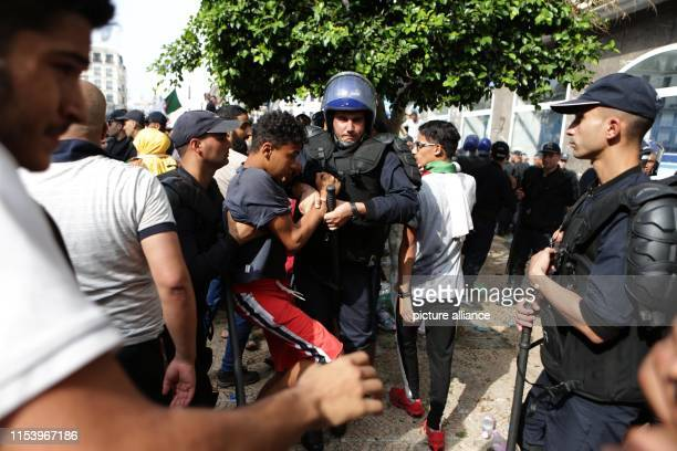 Algerians scuffle with security forces during a march calling for the departure of the Algerian regime coinciding with the Algerian Independence Day...