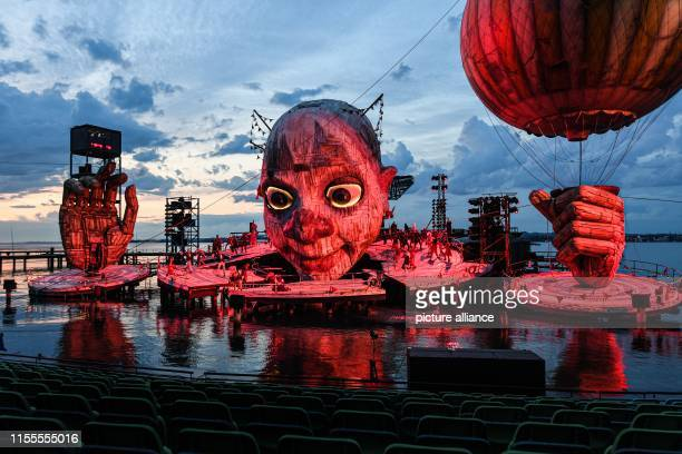 """July 2019, Austria, Bregenz: A scene from Verdi's opera """"Rigoletto"""" during photo rehearsal on the lake stage as part of the Bregenz Festival. The..."""