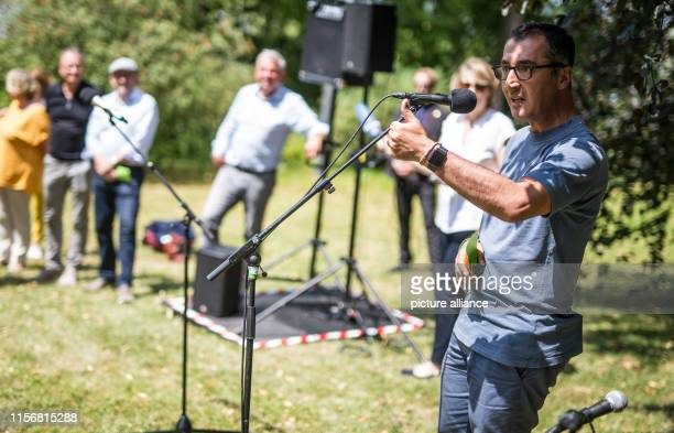"July 2019, Baden-Wuerttemberg, Stuttgart: Cem Özdemir speaks with young people at the event ""Zu Hören - Zuhören"" in the park of the Villa..."