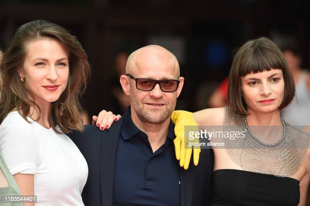 Before the world premiere of the film Stillstehen the actress Natalia Belitski the actor Jürgen Vogel and the author and director Elisa Mishto stand...
