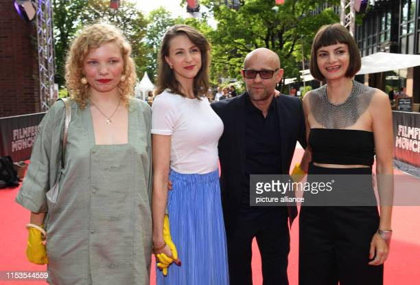LuisaCéline Gaffron the actress Natalia Belitski the actor Jürgen Vogel and the author and director Elisa Mishto are standing on the red carpet at...