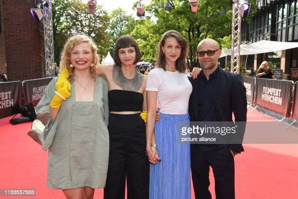 LuisaCéline Gaffron the author and director Elisa Mishto the actress Natalia Belitski and the actor Jürgen Vogel are standing at the Red Carpet at...