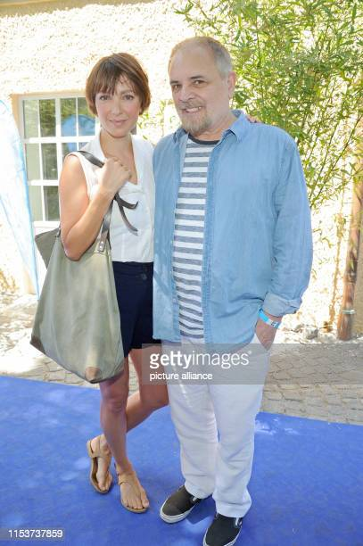 The actress Julia Koschitz and the director Uli Edel come to the reception of the FilmFernsehFonds Bayern during the Munich Film Festival Photo...