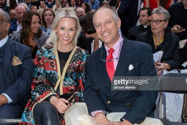 Prince Wolfgang and Princess Tatiana of Bavaria are sitting next to Bernd Sibler Bavarian Minister of State for Science and the Arts in the courtyard...