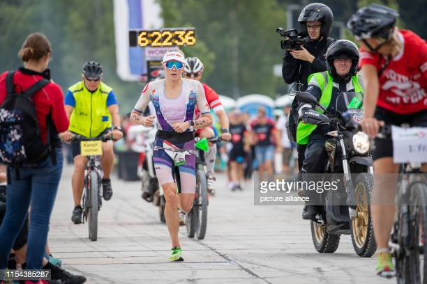 Lucy CharlesBarclay triathlete from Great Britain runs along the harbour at the Datev Challenge Roth In the 18th edition of the triathlon the...