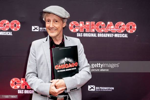 Santiago Ziesmer actor and dubbing artist is standing in front of a photo wall in front of the VIP premiere of CHICAGO The Musical in the courtyard...