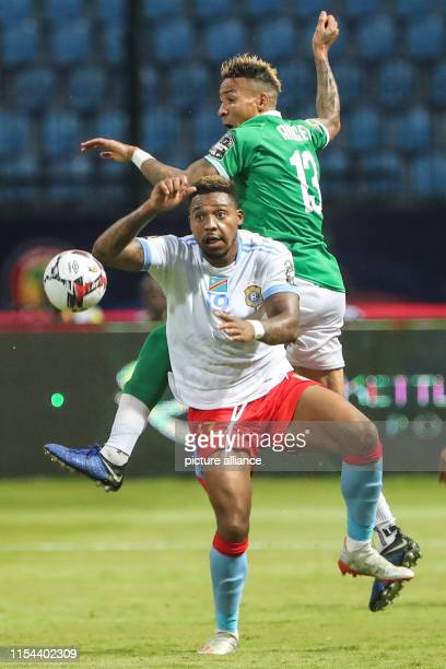 DR Congo's Britt Assombalonga vies for the ball with Madagascar's Anicet Abel during the 2019 Africa Cup of Nations round of 16 soccer match between...