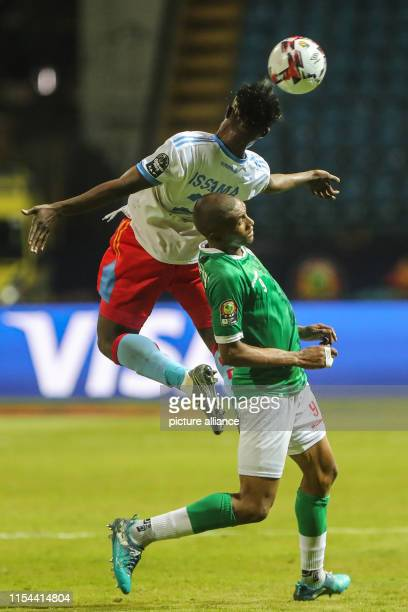DR Congo's Djos Issama vies for the ball with Madagascar's Faneva Andriatsima during the 2019 Africa Cup of Nations round of 16 soccer match between...