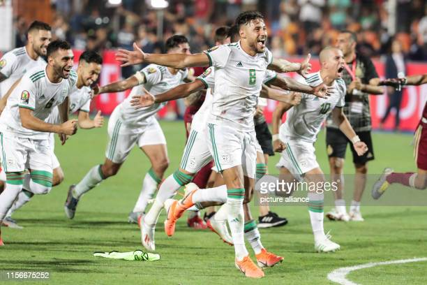 Algeria players celebrate victory after winning the 2019 Africa Cup of Nations final soccer match between Senegal and Algeria at the Cairo...