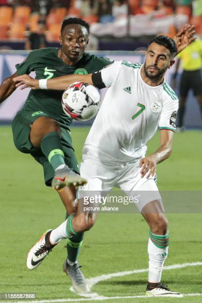 July 2019, Egypt, Cairo: Algeria's Riyad Mahrez and Nigeria's Ahmed Musa battle for the ball during the 2019 Africa Cup of Nations semi-final soccer...