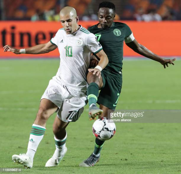 July 2019, Egypt, Cairo: Algeria's Sofiane Feghouli and Nigeria's Ahmed Musa during the 2019 Africa Cup of Nations semi-final soccer match between...