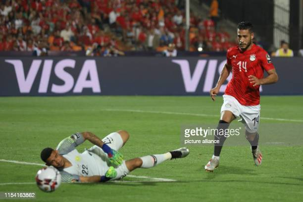 Egypt's Ahmed Ali in action against South Africa goalkeeper Ronwen Williams during the 2019 Africa Cup of Nations round of 16 soccer between Egypt...
