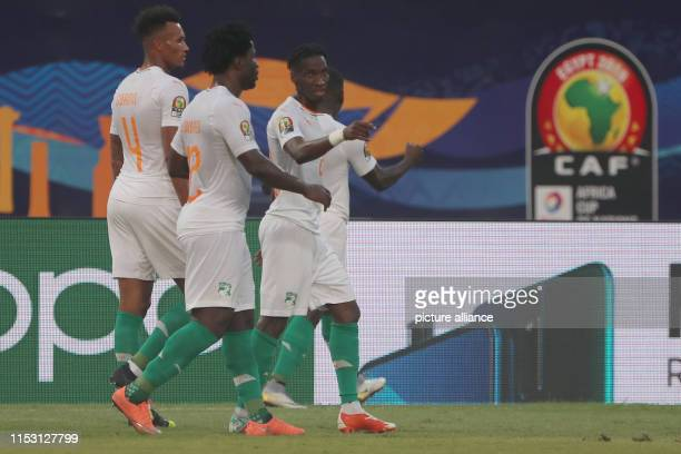 July 2019, Egypt, Cairo: Ivory Coast players celebrate scoring their side's first goal during the 2019 Africa Cup of Nations Group C soccer match...