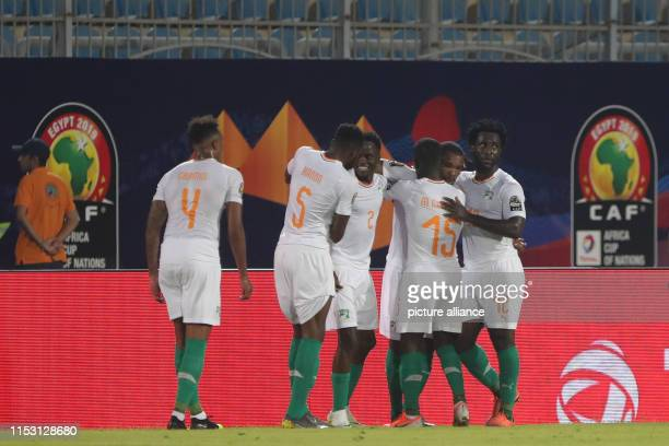 July 2019, Egypt, Cairo: Ivory Coast players celebrate scoring their side's second goal during the 2019 Africa Cup of Nations Group C soccer match...