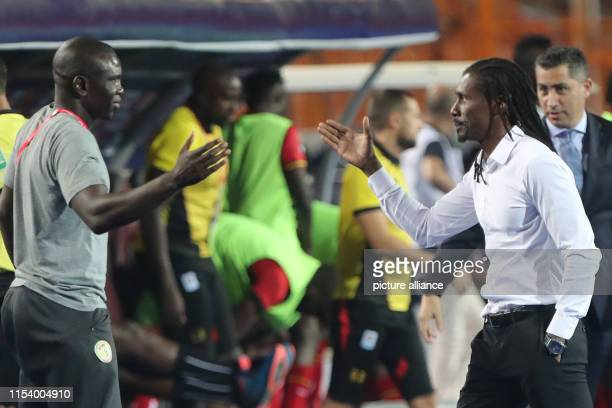 Senegal's national team coach Aliou Cisse leaves after the 2019 Africa Cup of Nations round of 16 soccer match between Uganda and Senegal at Cairo...