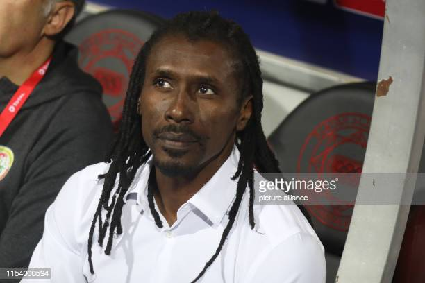Senegal's national team coach Aliou Cisse looks on during the 2019 Africa Cup of Nations round of 16 soccer match between Uganda and Senegal at Cairo...