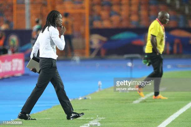 Senegal's national team coach Aliou Cisse stands on the touchline during the 2019 Africa Cup of Nations round of 16 soccer match between Uganda and...