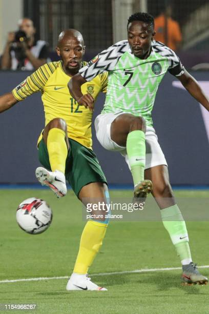 July 2019, Egypt, Cairo: South Africa's Kamohelo Mokotjo and Nigeria's Ahmed Musa battle for the ball during the 2019 Africa Cup of Nations quarter...