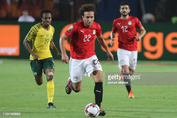 South Africa's Percy Tau and Egypt's Amr Warda vie for the ball during the 2019 Africa Cup of Nations round of 16 soccer between Egypt and South...