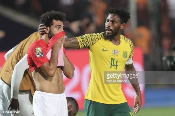 South Africa's Thulani Hlatshwayo consoles Egypt's Mohamed Salah after the final whistle of the 2019 Africa Cup of Nations round of 16 soccer between...