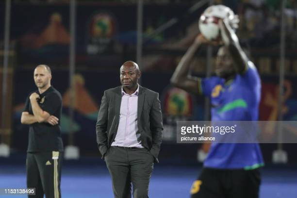 July 2019, Egypt, Cairo: Tanzania's Emmanuel Amunike reacts on the touchline during the 2019 Africa Cup of Nations Group C soccer match between...