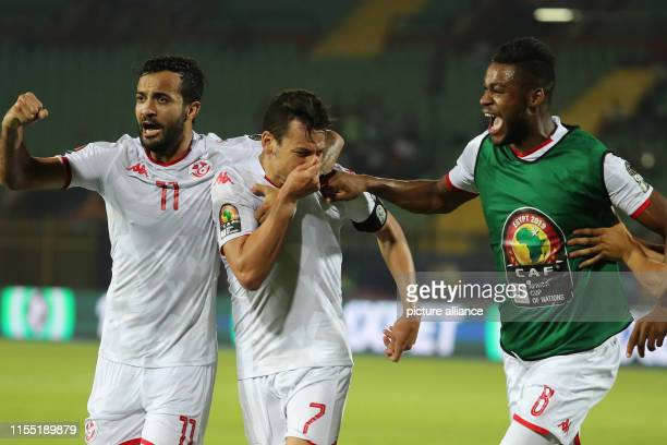 July 2019, Egypt, Cairo: Tunisia players celebrates scoring their side's second goal during the 2019 Africa Cup of Nations quarter final soccer match...