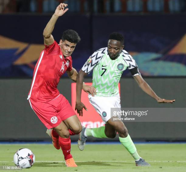 July 2019, Egypt, Cairo: Tunisia's Mohamed Drager vies for the ball with Nigeria's Ahmed Musa during the 2019 Africa Cup of Nations third place final...