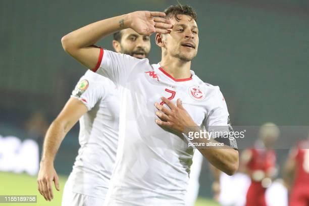 July 2019, Egypt, Cairo: Tunisia's Youssef Msakni celebrates scoring his side's second goal during the 2019 Africa Cup of Nations quarter final...